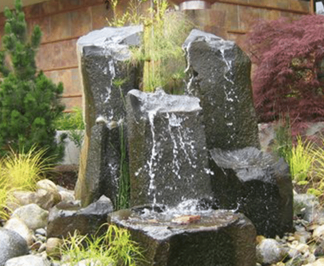 water feature with stonework and waterfall