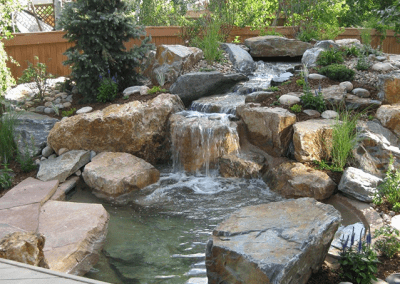 inspiring-backyard-water-feature-small-pond-grey-rocks-green-plant-decoration-backyard-water-falls-pool-garden-outdoor-good-design-i[1]